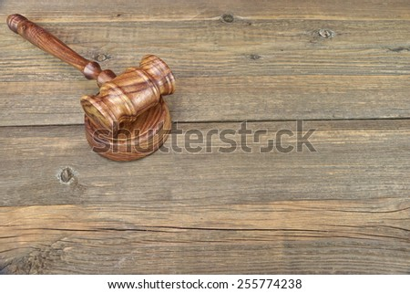 Vintage Judges Gavel On Grunge Wood Table - stock photo