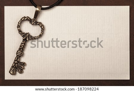 Vintage key and paper texture background with space for your text or image