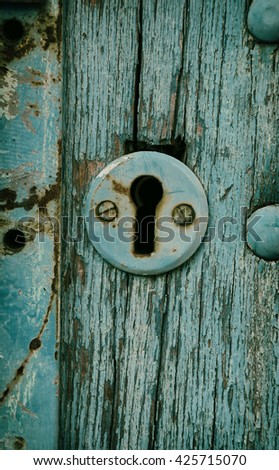 Vintage keyhole in an old blue door - stock photo