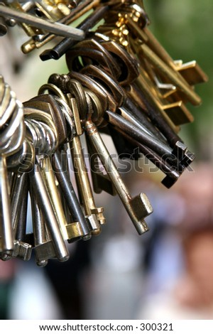 Vintage keys hanging from keyring - blurry background - stock photo