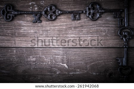 Vintage keys on old wooden boards. Frame or background. Space for text. Toned. - stock photo