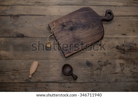 Vintage kitchen silverware  and utensils on a wooden background - stock photo