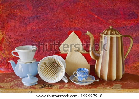 vintage kitchen utensils to brew coffee in an old school way - stock photo