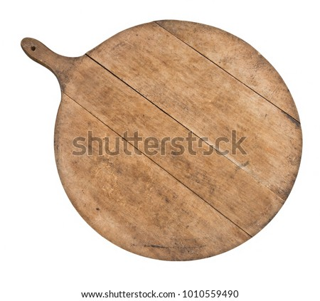 Vintage kitchenware. Genuine old wood cutting board, breadboard, isolated on white. Round (more or less) with handle.