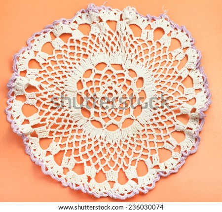 vintage knitting craftsmanship - placemat with embroidered crochet lace - stock photo