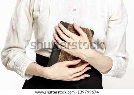 Vintage lady holding ancient book in beautiful hands - stock photo