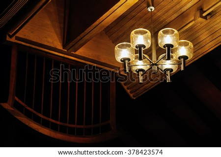 Vintage lamp hanging from ceiling - stock photo