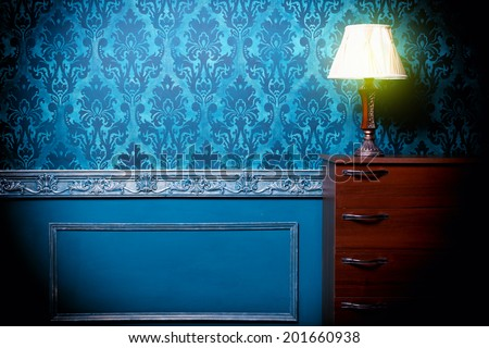 Vintage lamp in retro blue toned interior. Rococo fashion decor. Rustic wallpaper. Luxurt concept - stock photo
