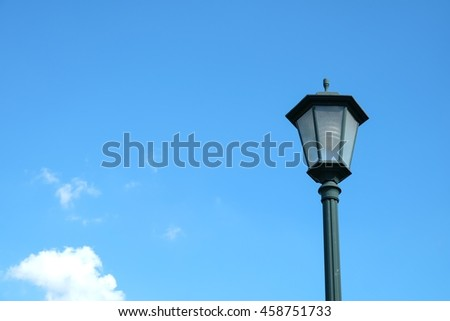 Vintage lamp on blue sky background with copy space