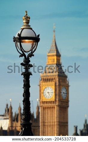 Vintage lamp post on Westminster Bridge with Big Ben in London..