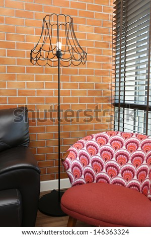 Vintage lamp with a colorful chair and sofa - stock photo