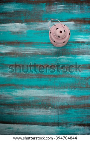 Vintage lantern with a  candle on a old wooden background. Vignette. Top view. Vertical image. - stock photo