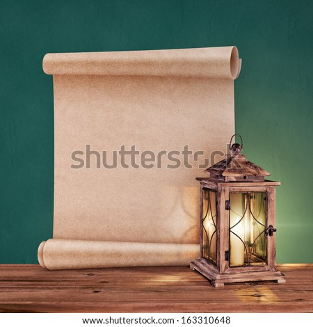 vintage lantern with antique scroll on green background - stock photo