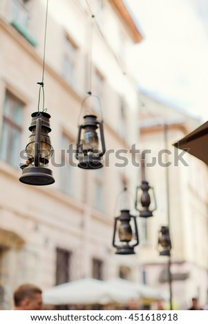 vintage lanterns with candles on the street - stock photo