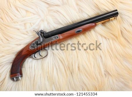 Vintage large-bore hunting pistol (.58 cal.) British colonial weapon from the early 19th century. This gun's use as the last line of defense against an attacking tiger and other dangerous animal. - stock photo