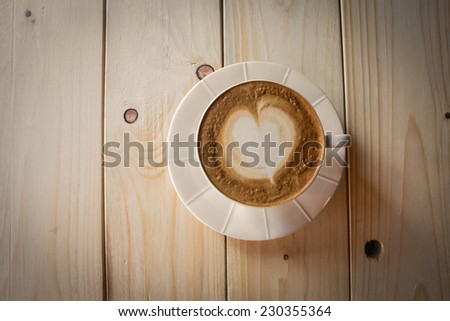Vintage latte art coffee - stock photo