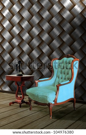 Vintage leather armchair with wood wall background - stock photo