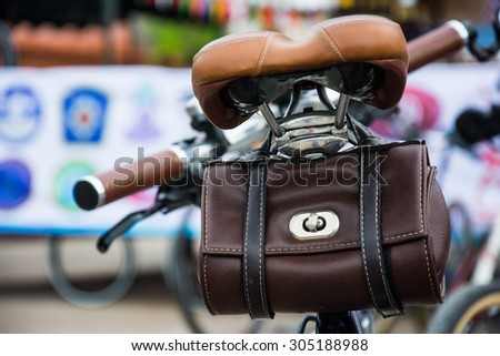 vintage leather bicycle bag on seat