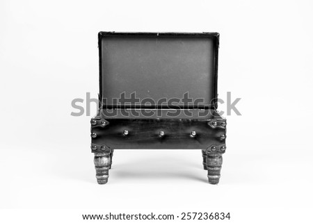 Vintage leather ottoman footrest with storage, open top. Front view. Black and white - stock photo