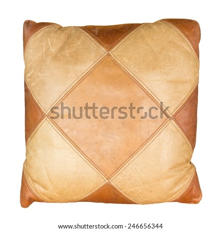 vintage leather pillow on white background - stock photo