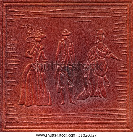 vintage leathercraft tooled book cover with texture and silhouettes