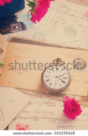 vintage letter  with copy space and old clock, retro toned - stock photo