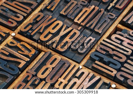 vintage letterpress wood type printing blocks in a typesetter drawer - stock photo