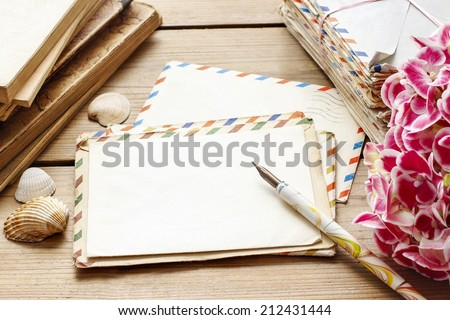 Vintage letters,books and pen - stock photo