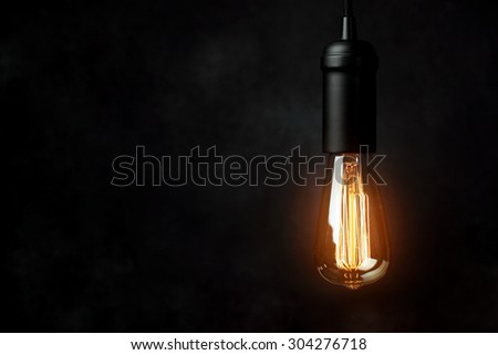 Vintage light bulb background - stock photo