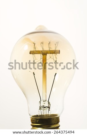 Vintage light bulb.Close up and used vintage filter. - stock photo