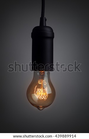 Vintage light bulb glowing