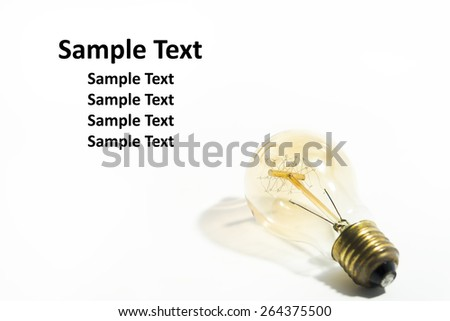 Vintage light bulb. On white background with copy space. - stock photo