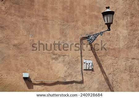 Vintage light on the rough wall of the building - stock photo