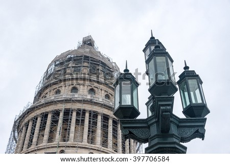 Vintage light post from Colonial times near The Capitolio or Capitol Building under reconstrution in Havana,Cuba - stock photo