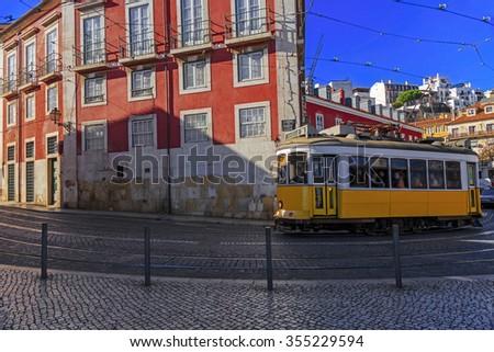 Vintage Lisbon tram on city street, sunny day, Portugal  - stock photo
