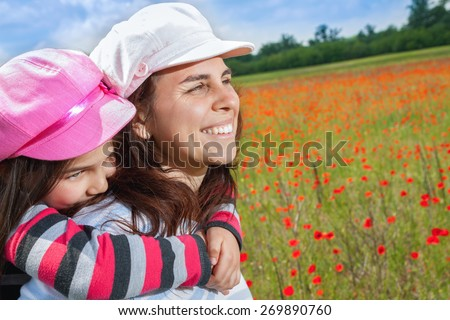 Vintage little girl, boy, mother playing on poppy field - stock photo