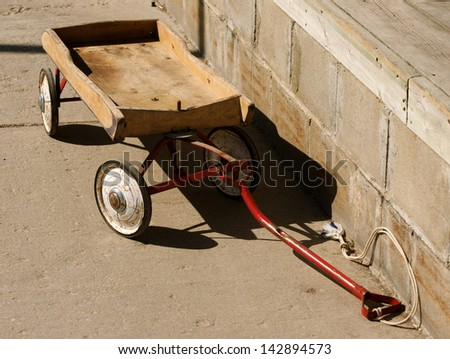 Vintage, little, wood wagon, symbolic of childhood
