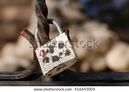 Vintage lock macro view. Security concept with closed silver padlock. soft focus, shallow depth of field - stock photo