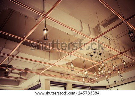 Vintage loft interior lighting lamp decor hang on ceiling - stock photo