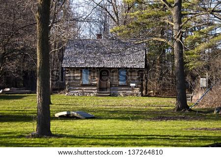 Vintage Log Cabin. Port Sanilac Historical Village. Port Sanilac, Michigan. - stock photo