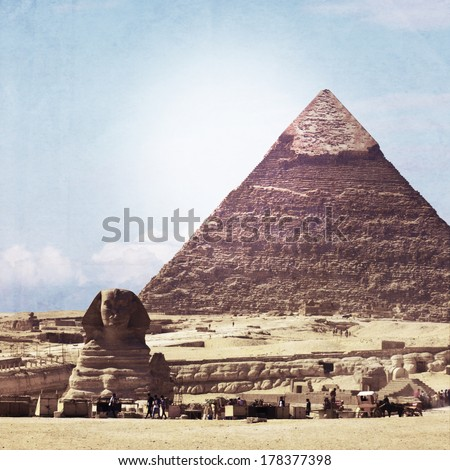 Vintage look of Sphinx and great Pyramid  - stock photo