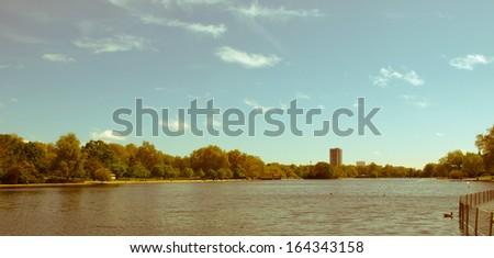 Vintage look Serpentine lake river in Hyde Park, London, UK - stock photo