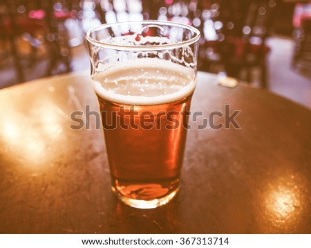 Vintage looking A pint of English ale beer in a pub - stock photo