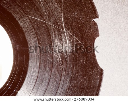 Vintage looking Badly damaged scratched vinyl record vintage analog music recording medium - stock photo