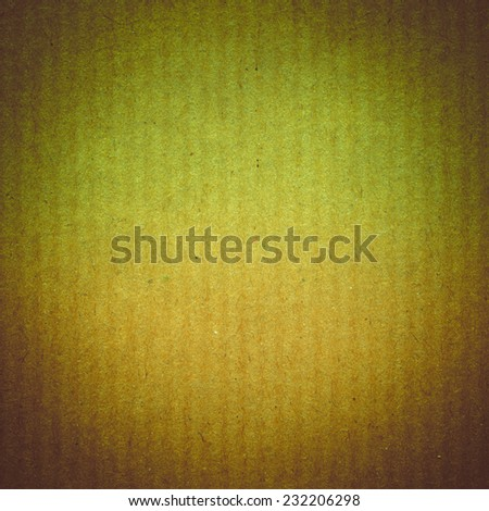 Vintage looking Blank sheet of brown paper useful as a background - stock photo
