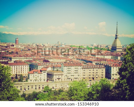 Vintage looking City of Turin (Torino) skyline panorama seen from the hill - stock photo