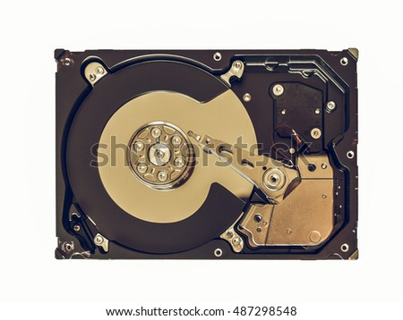 Vintage looking Detail of a computer hard disk for data storage isolated over white