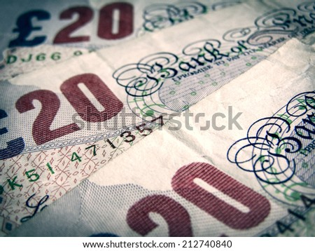 Vintage looking Detail of British Pound coins banknotes money - stock photo