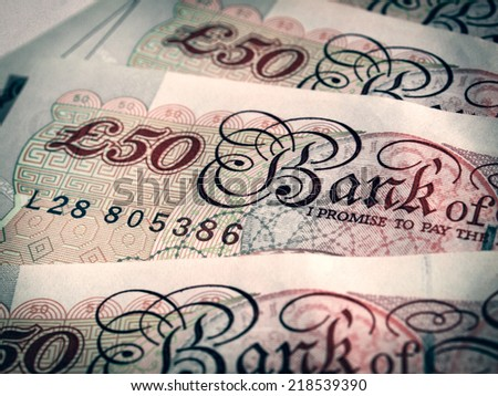 Vintage looking Detail of British Pounds banknotes money - stock photo