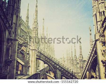 Vintage looking Duomo di Milano gothic cathedral church, Milan, Italy - stock photo
